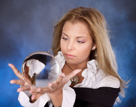 Young beautiful woman with crystal ball. Stock Photo - 7890181