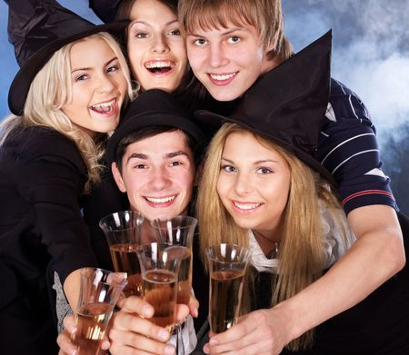 halloween party: Group young people drink champagne at nightclub.