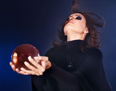 Young beautiful woman with crystal ball. Stock Photo - 7890185