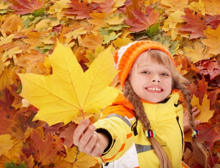 Little girl in autumn orange leaves. Outdoor. Stock Photo - 7890190