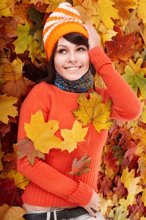 one young woman only: Young woman in autumn orange leaves. Outdoor.