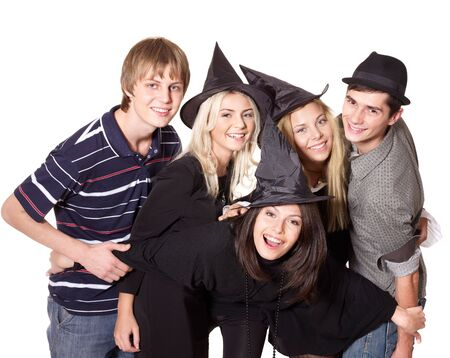Group young people at party in witch hat. Isolated. Stock Photo - 7890202