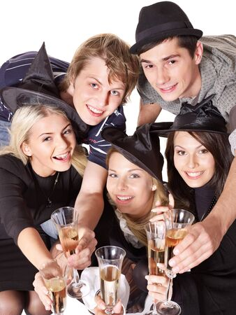 Group young people at party in witch hat. Isolated. Stock Photo - 7890203