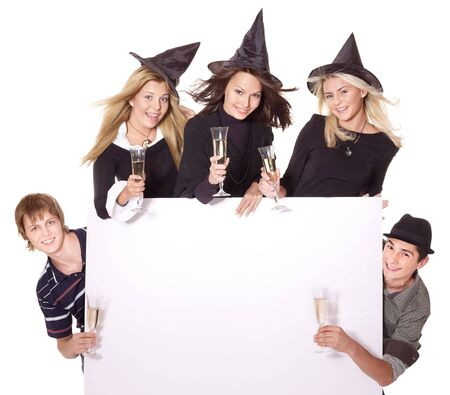 Group young people at party in witch hat. Isolated. photo