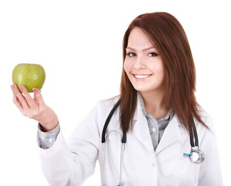 Medicine doctor with stethoscope and green apple. Isolated. photo