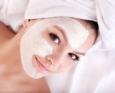Young woman with clay facial mask. Stock Photo - 8122520