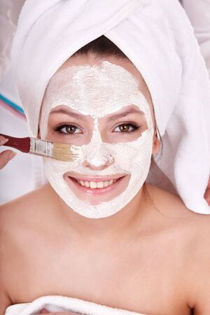 Young woman with clay facial mask. Stock Photo - 8122541