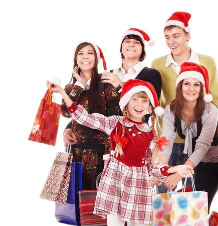 ni�os de compras: Grupo feliz personas con hijos en santa sombrero. Aislado.  Foto de archivo