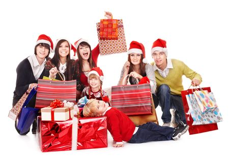 Happy group people with children in santa hat .  Isolated. Stock Photo - 8122525