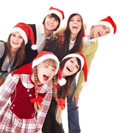 Happy group people with children in santa hat .  Isolated. Stock Photo - 8122479