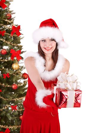 Christmas girl in santa hat holding stack  gift box.. Isolated. Stock Photo - 8122498