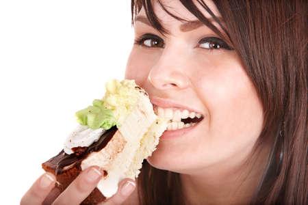 ni�a comiendo: Cara de ni�a comer pastel. Aislado.