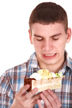 Face of man eating cake. Isolated. Stock Photo - 8116402
