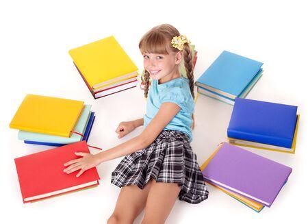 schoolchild: Little girl  with open book lying on floor.