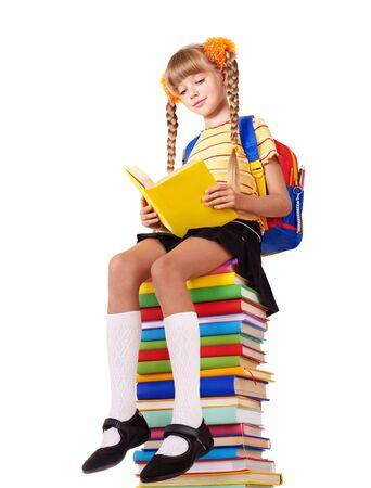 schoolchild: Schoolgirl sitting on pile of books. Isolated. Stock Photo