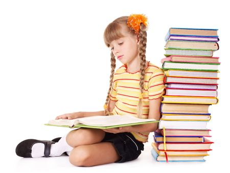 Schoolgirl  reading pile of books. Isolated. photo