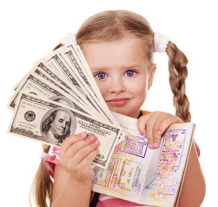 Little girl holding international passport. Foreign vacation. photo
