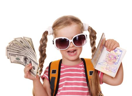Little girl holding international passport and money. Foreign vacation. photo