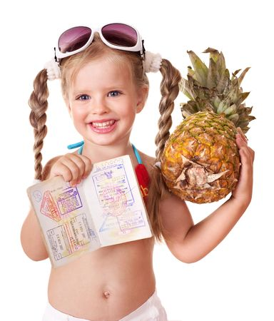 Little girl  holding international passport. Foreign vacation. photo