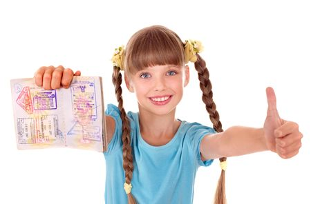 Little girl holding  passport. Foreign vacation. photo