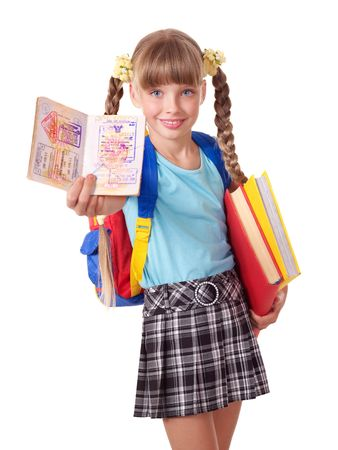 Child with pile of books and passport. Foreign education. photo