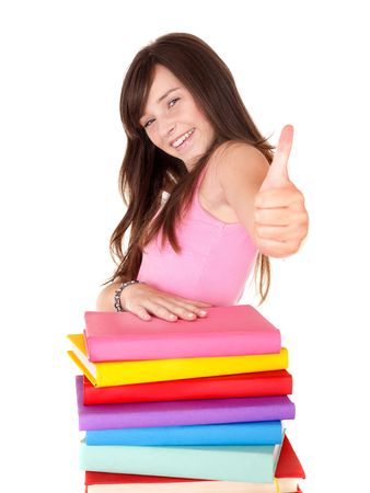 Girl with pile book showing thumb up. Isolated. Stock Photo - 8116427