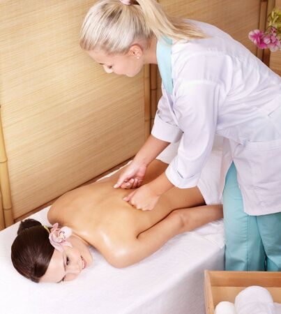 Young beautiful woman on massage table in beauty spa.  Series. photo