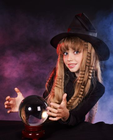 clairvoyant: Little girl witch holding crystal ball.