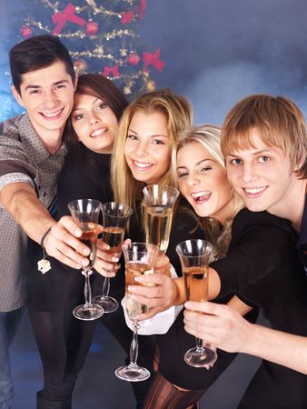 Group young people drinking champagne at nightclub. Christmas. photo