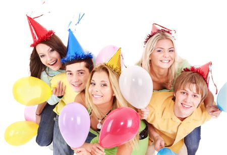 Group of young people in party hat holding balloon. Isolated.
