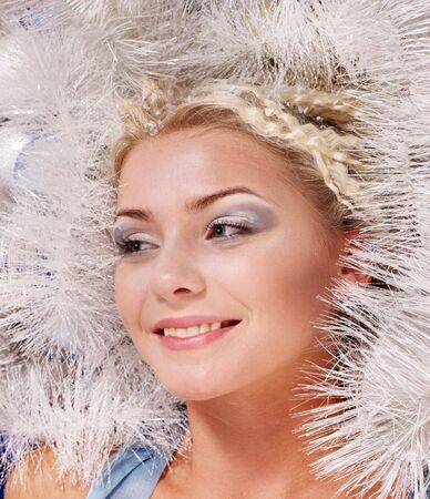Young beautiful woman with snow. Fashion studio shot. photo