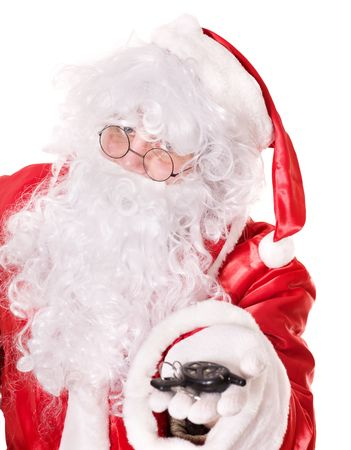 Santa claus  holding car keys . Isolated. photo
