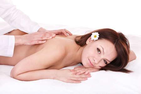masseuse: Beautiful young woman having massage. Stock Photo