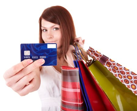 Young woman holding group shopping bag. Isolated.Sharpness is on a credit card Stock Photo