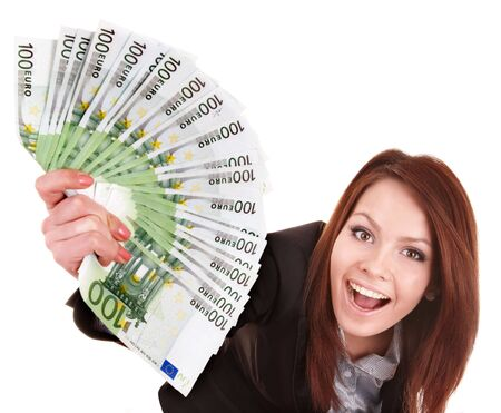 forex: Young woman holding euro money.  Isolated.