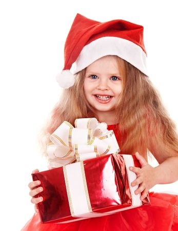 Little girl in red dress holding gift box. Isolated. photo