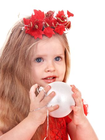 Little girl in red dress holding christmas ball. Isolated. photo