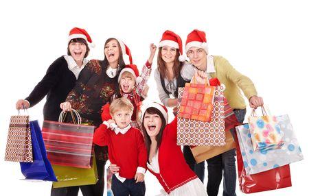 fiesta familiar: Grupo feliz personas con hijos en santa sombrero. Aislado.  Foto de archivo