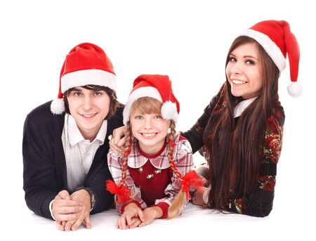 Happy family with child in santa hat. Isolated. photo