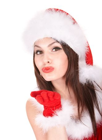 Girl in santa hat blowing kiss.   Isolated. photo