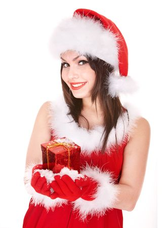 Christmas girl in santa hat holding red gift box,snow. Isolated. photo