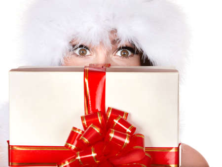 Girl in santa hat holding gift box.    Isolated. Stock Photo - 8239196