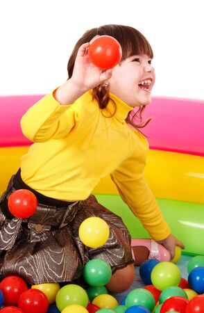 Happy little girl in group colourful ball. Isolated. photo
