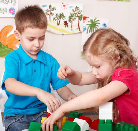 constraction: Children playing construction set .