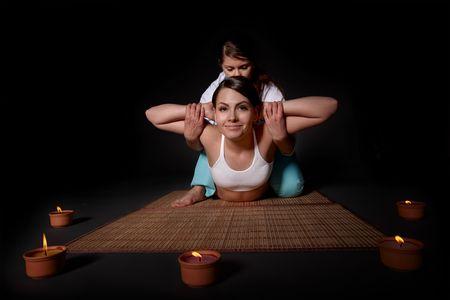 parlor: Beautiful white girl having thai massage. Beauty spa.