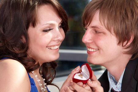 Man propose marriage to beautiful girl. photo