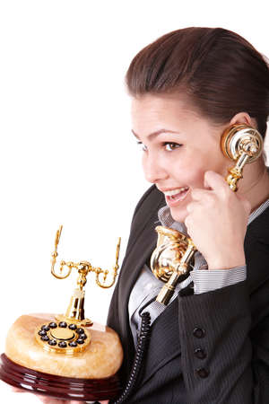 Happy businesswoman with golden phone. Isolated. Stock Photo - 8239318