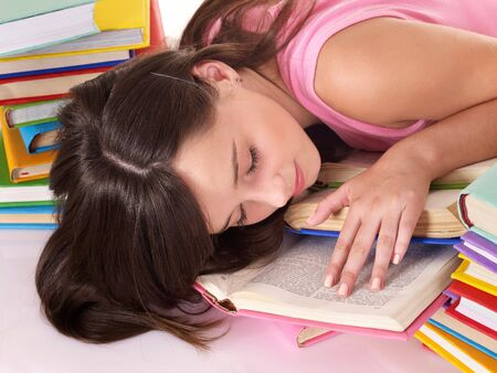 sleeping at desk: Girl sleep on pile of book. Education.