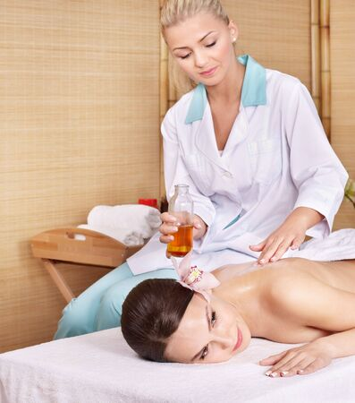 Young woman on massage table in beauty spa.  Series. Stock Photo - 8227274