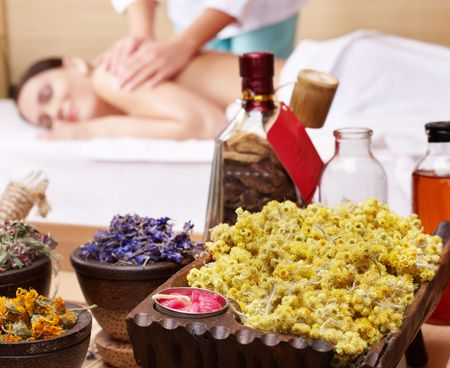 aromatherapy: Young beautiful woman on massage table in beauty spa. Series.